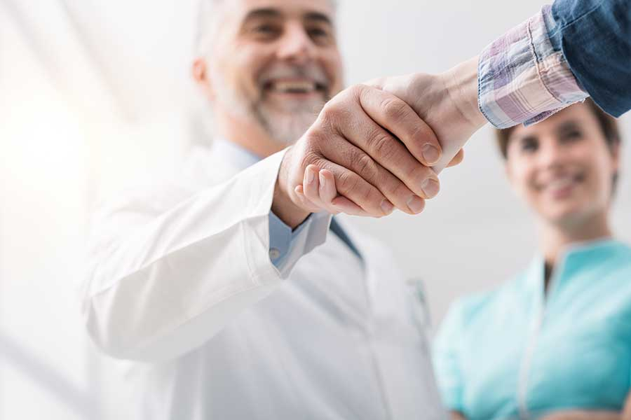 ENT Otago - Doctor and patient shaking hands